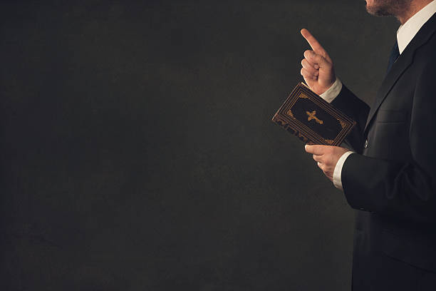 man with a bible and a wagging finger - preacher stock photos and pictures
