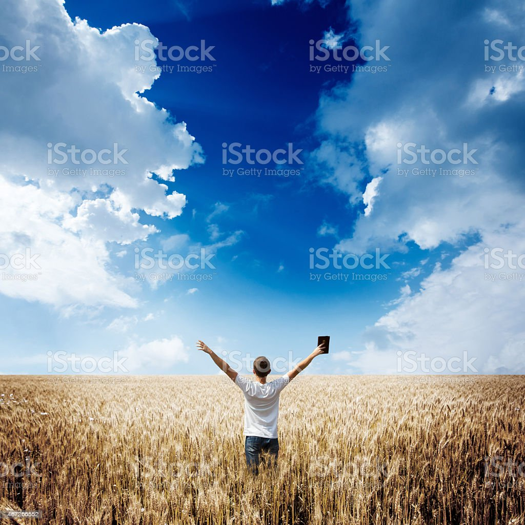 man with a bible stock photo