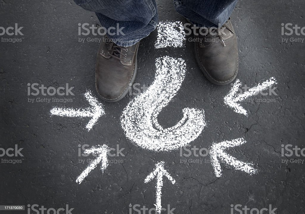 Man with a big question mark stock photo