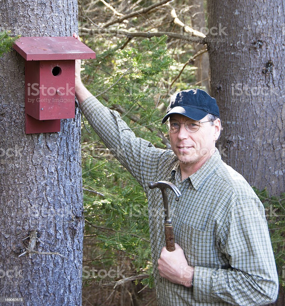 Man with a birdhouse royalty-free stock photo
