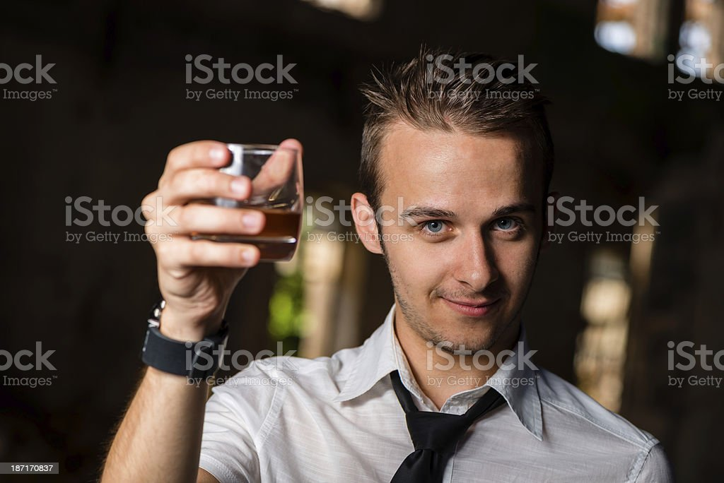 man with a bottle of wine stock photo