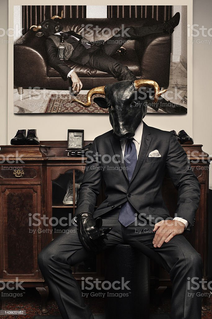 Man with a bull's head stock photo