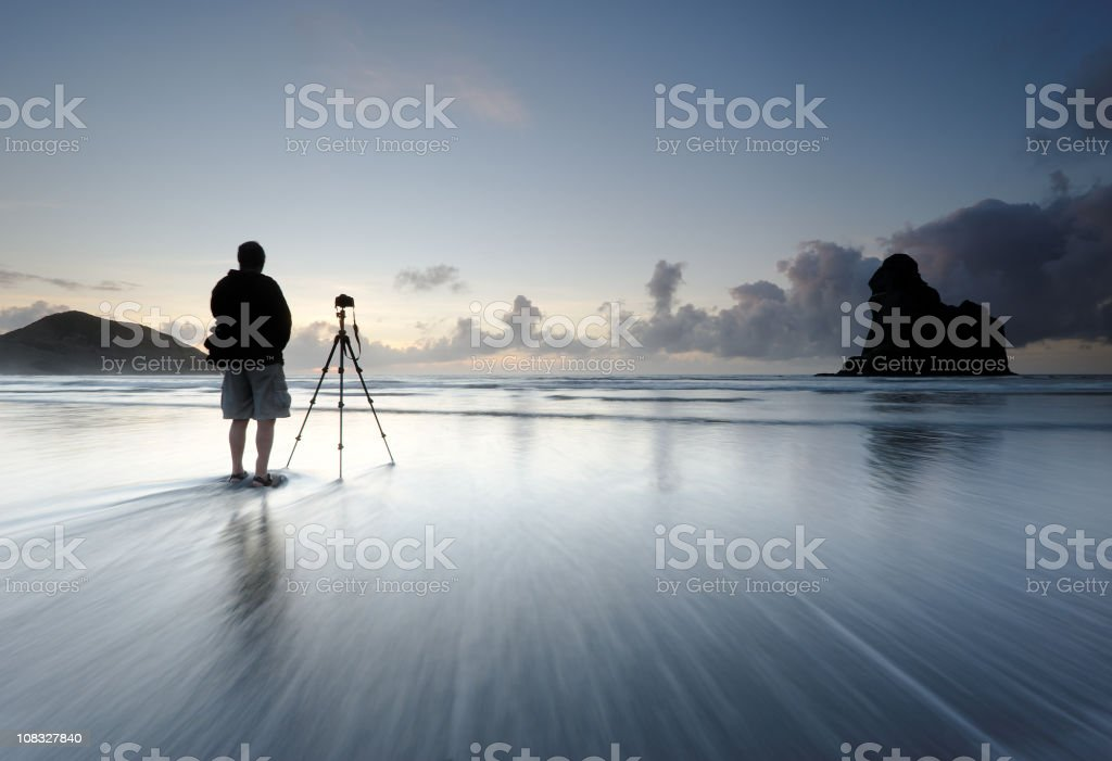 A man with a camera outside waiting for the light stock photo
