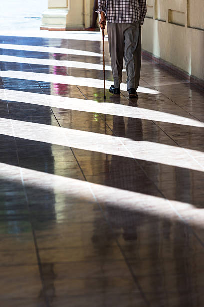 man with a cane - old man feet stock photos and pictures