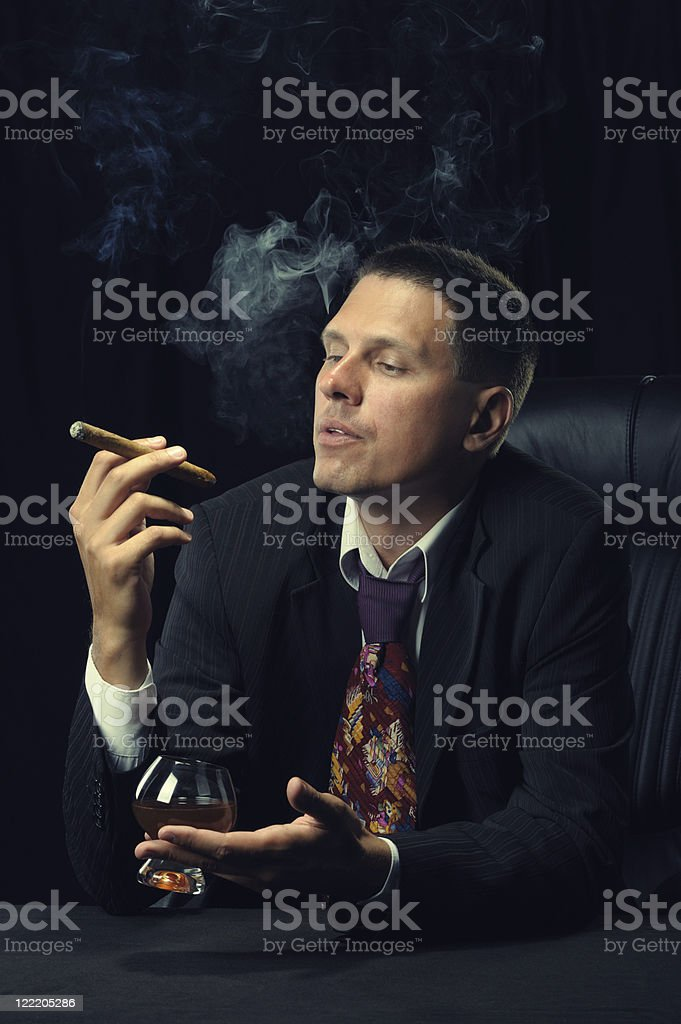 Man with a cigar and  glass of cognac royalty-free stock photo