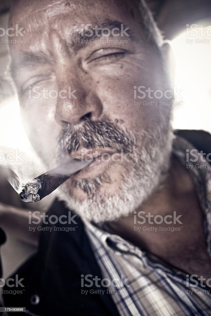 Man with a cigar stock photo