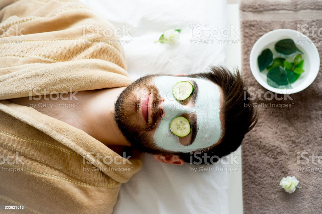 Man with a clay mask stock photo