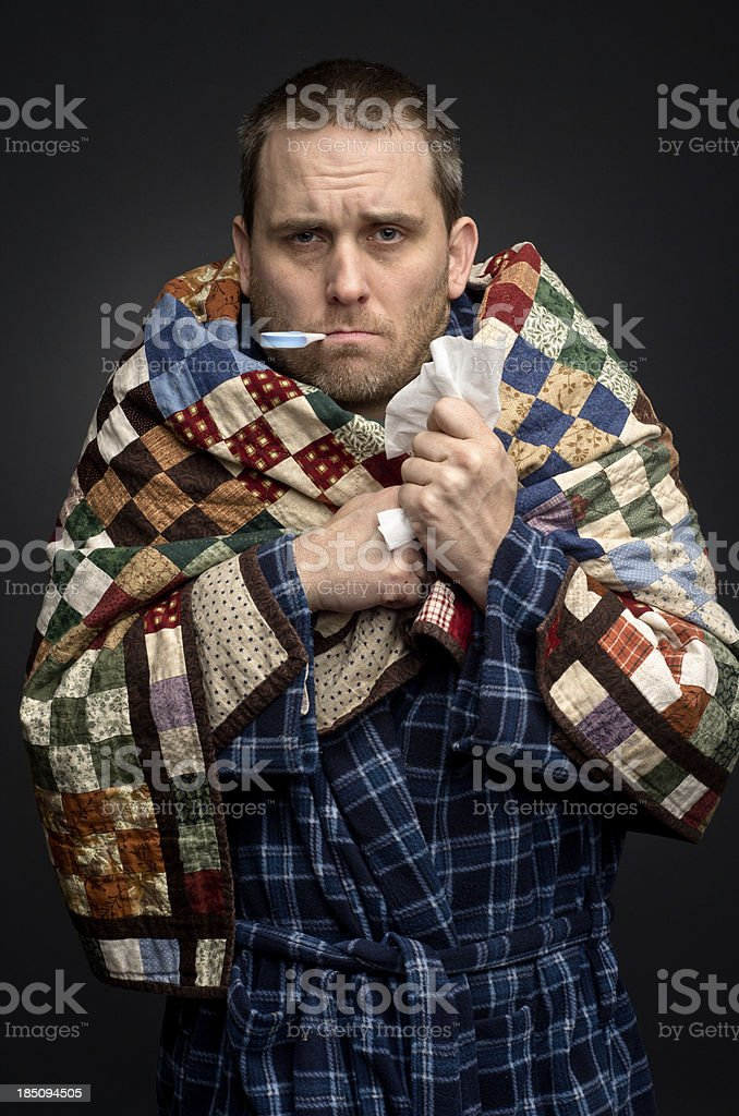 Man with a cold taking temperature royalty-free stock photo