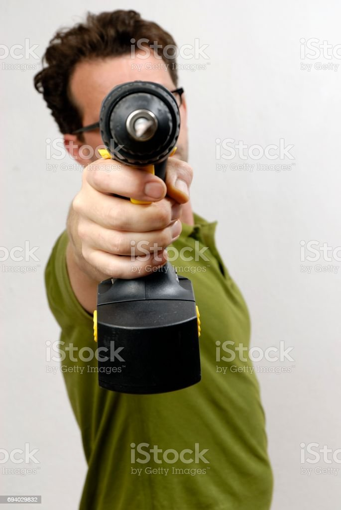 A Man with a cordless screwdriver stock photo