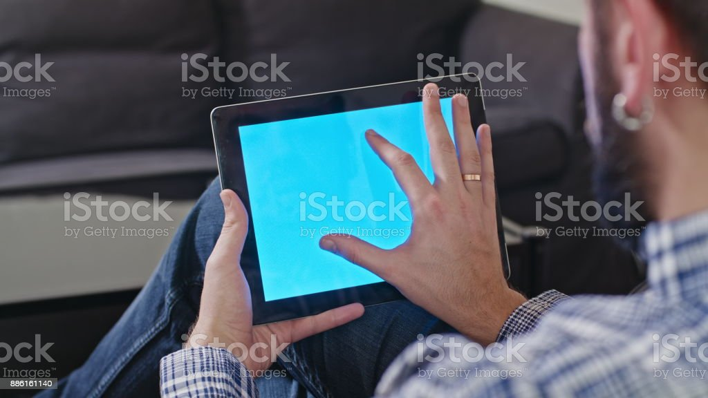 Man with a Digital Tablet with Blue Screen stock photo