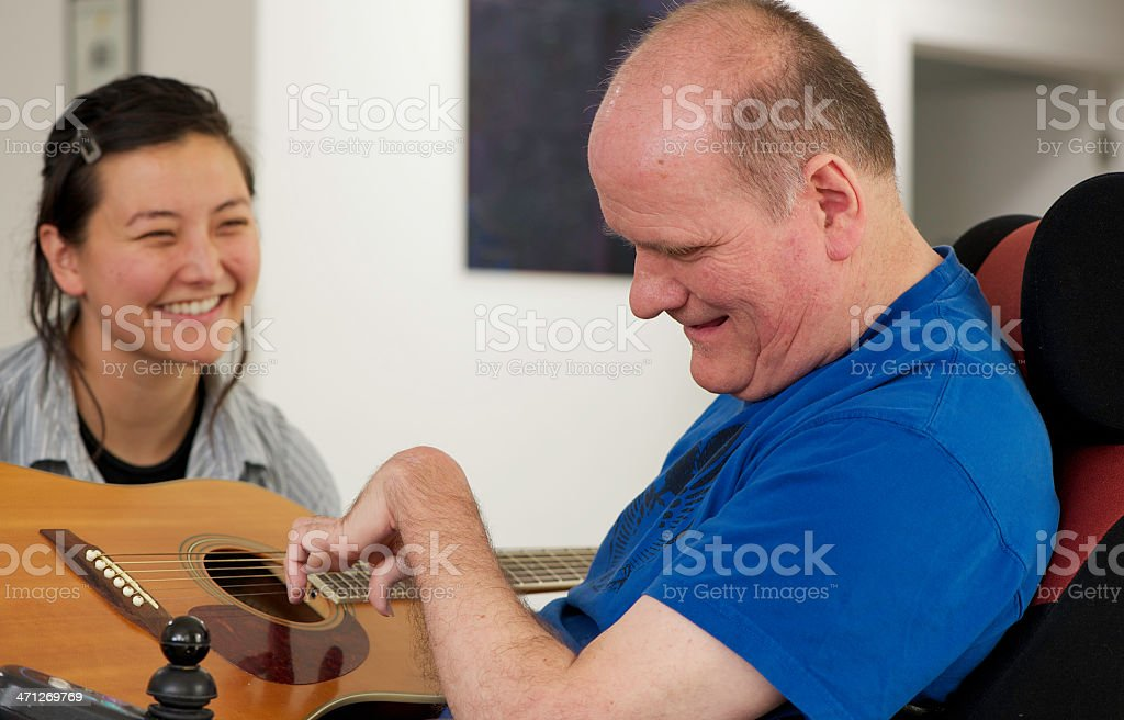 Man with a Disability playing Guitar stock photo
