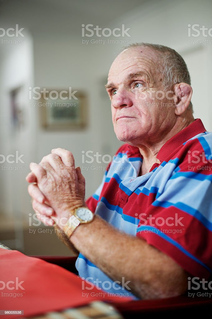 Man with a disability seated at table. royalty free stockfoto