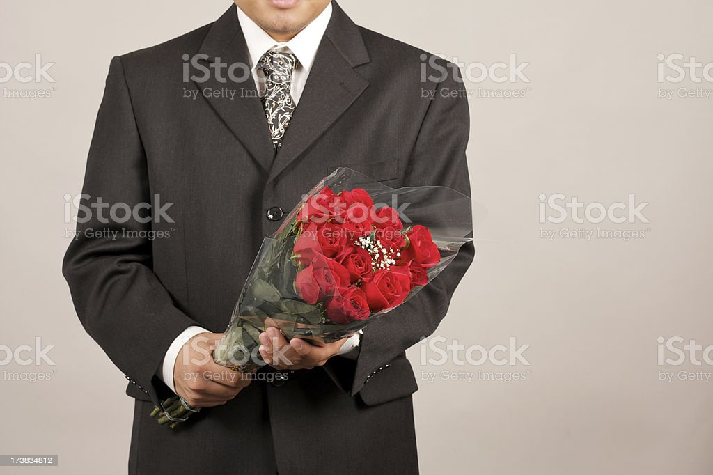 man with a dozen roses royalty-free stock photo