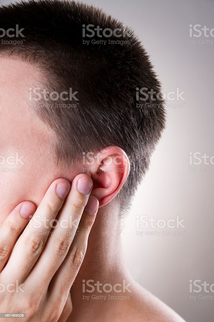 Man with a earache. Pain in the human body stock photo