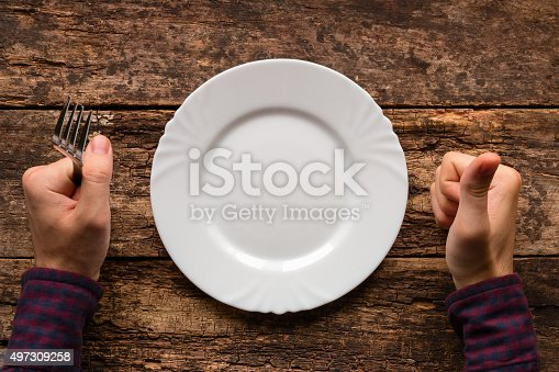 man with a fork in his hand indicates that the dish he liked