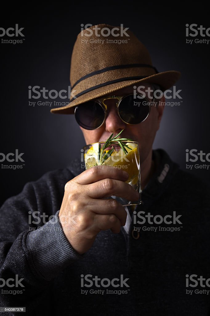 Man With A Glass Of Lemon Drink Stock Photo - Download Image