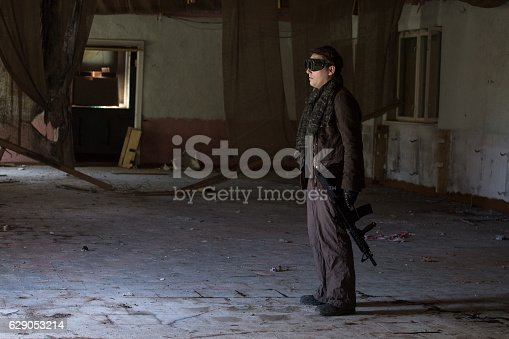 istock man with a gun in the Abandoned destroyed house 629053214