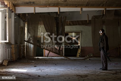 istock man with a gun in the Abandoned destroyed house 629053414