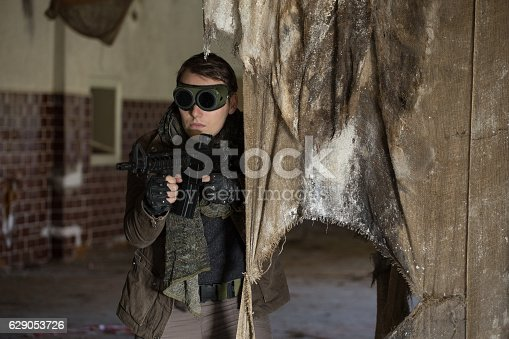 istock man with a gun in the Abandoned destroyed house 629053726