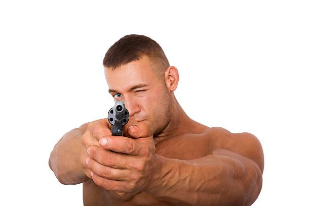 mann mit waffe, isoliert auf weißem hintergrund - killer workouts stock-fotos und bilder