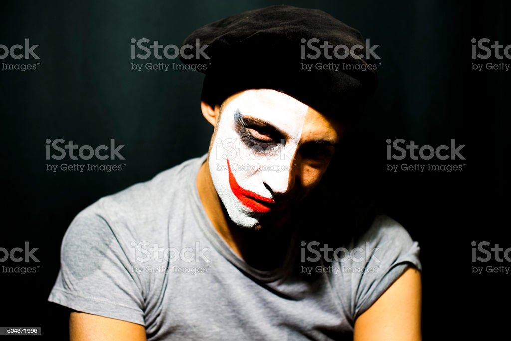 man with a half painted face stock photo