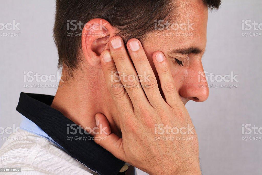 Man with a headache. Man with ear pain, Earache. Pain relief concept