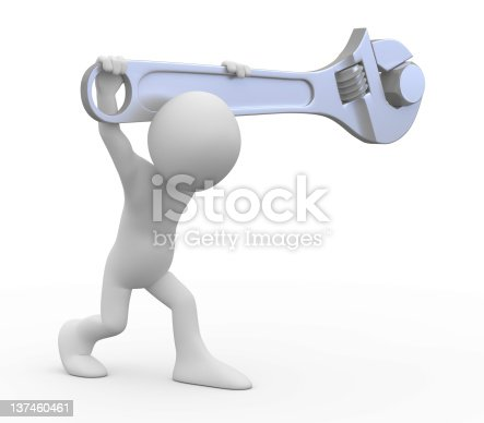 istock Man with a huge adjustable spanner 137460461