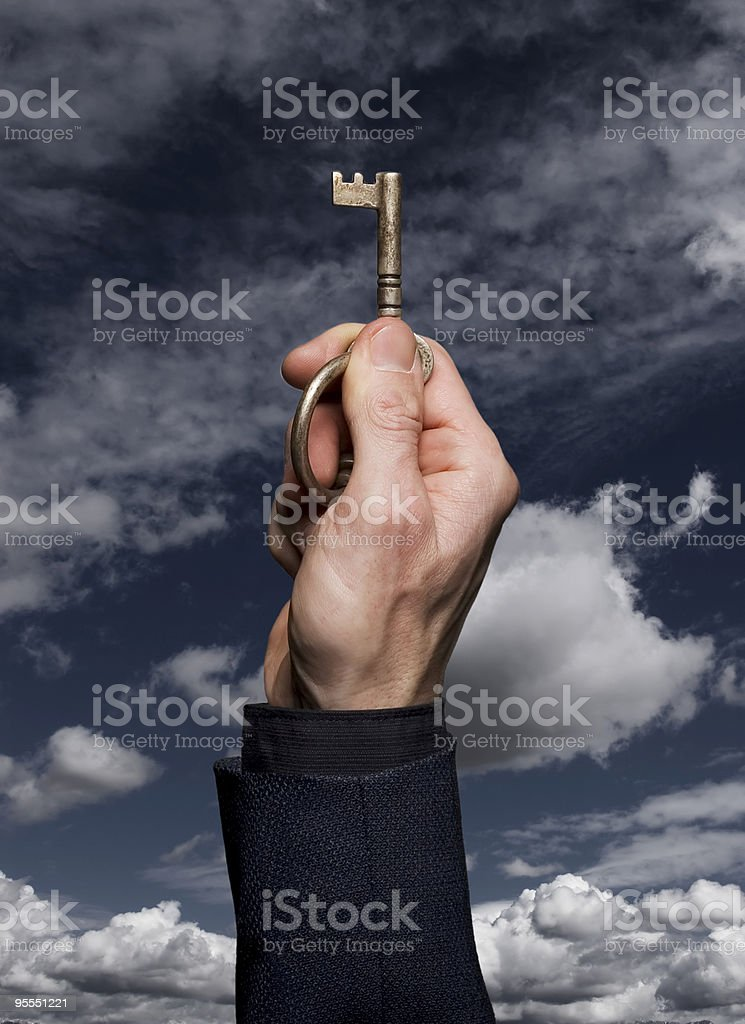 A man with a key unlocking the future royalty-free stock photo