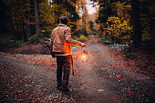 istock A man with a lantern at a crossroads in the woods 1283730033