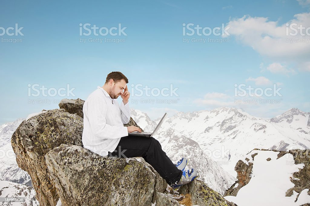 Man with a laptop on the top stock photo