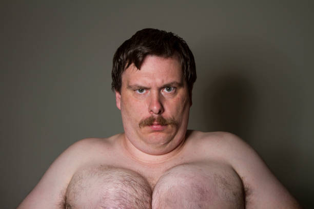 man with a large set of man breast stock photo