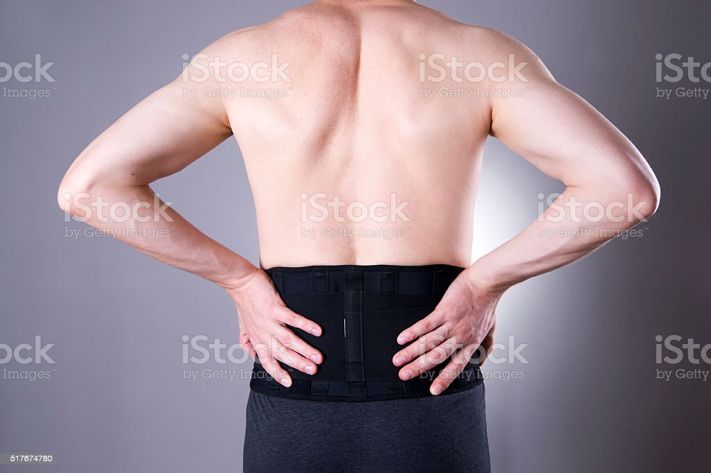 Man with a medical belt for the back stock photo