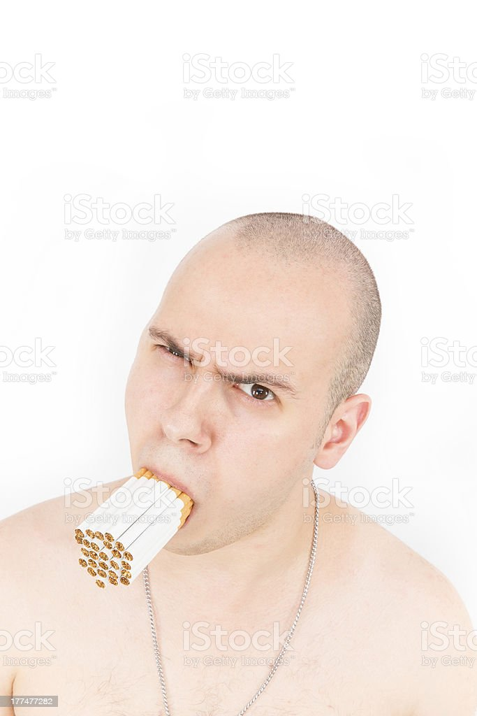 Man With a Mouth Full of Many Cigarettes royalty-free stock photo