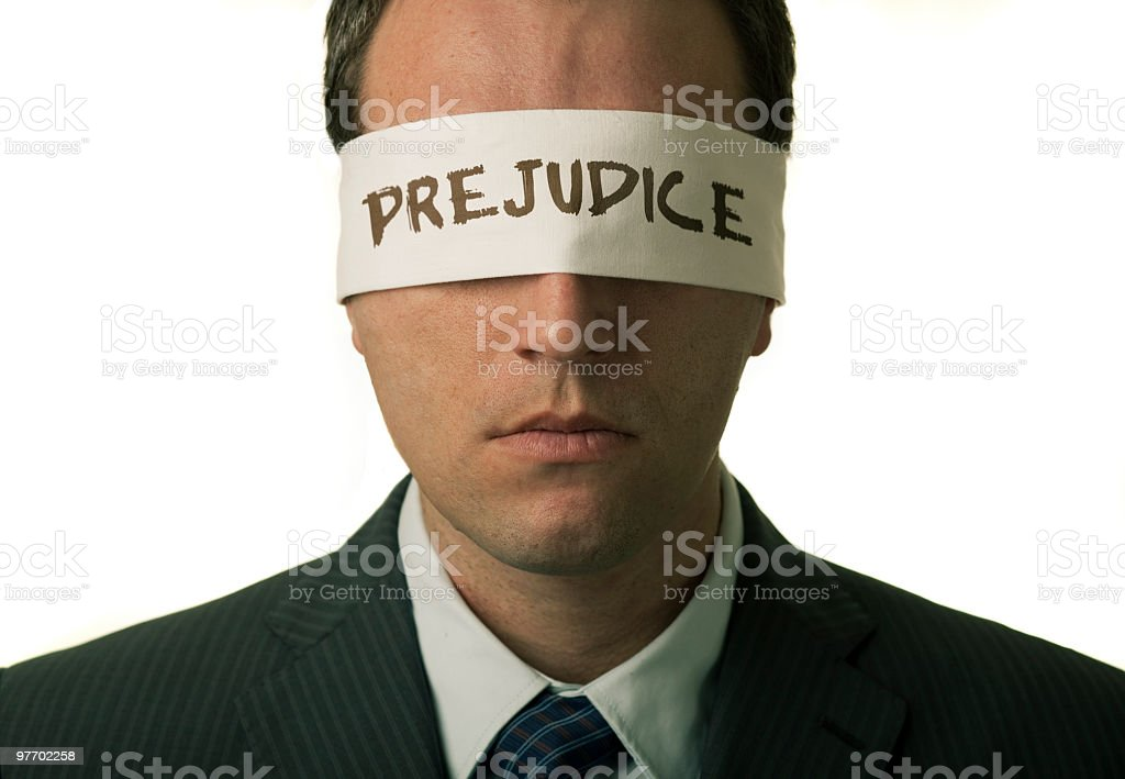 Man with a note that says Prejudice royalty-free stock photo