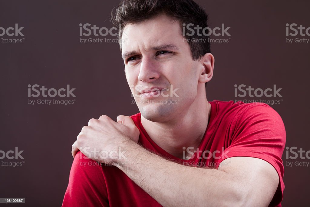 Man with a painful shoulder stock photo