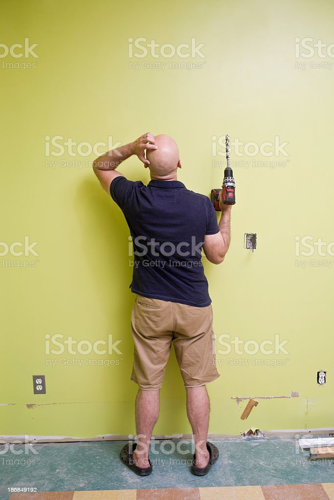 Man with a power drill doing home repairs royalty-free stock photo