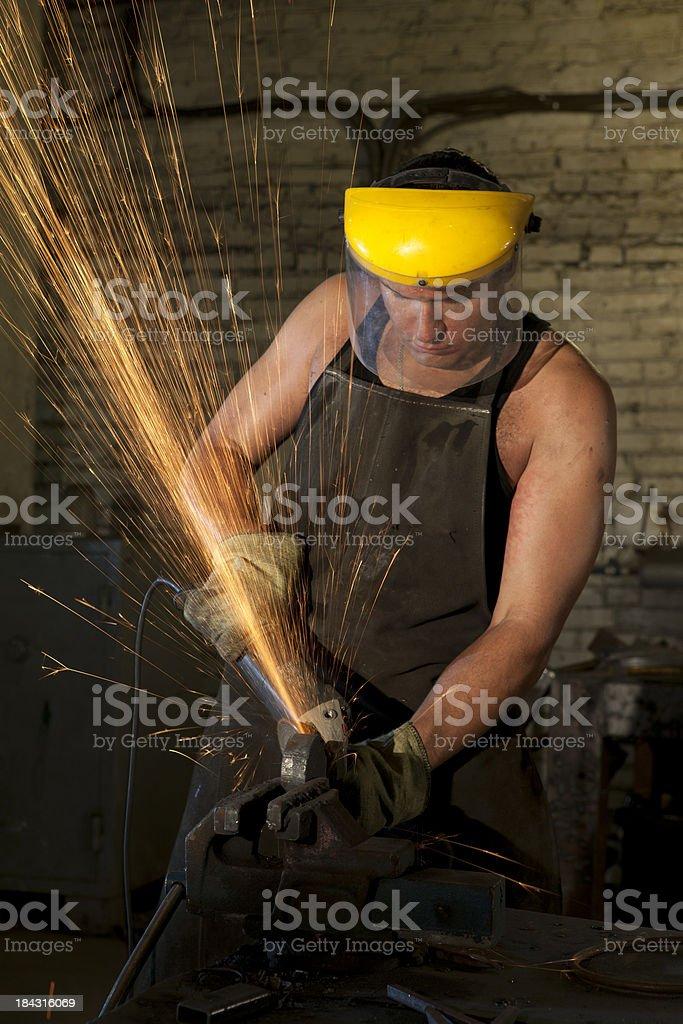 Mann mit einem power Schleifmaschine – Foto
