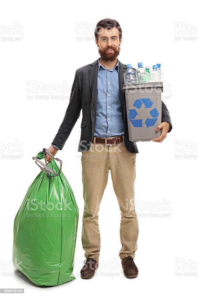 Man with a recycling bin and a garbage bag stock photo