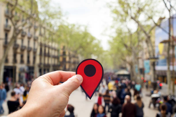 man with a red marker in las ramblas, barcelona - landmarks stock photos and pictures