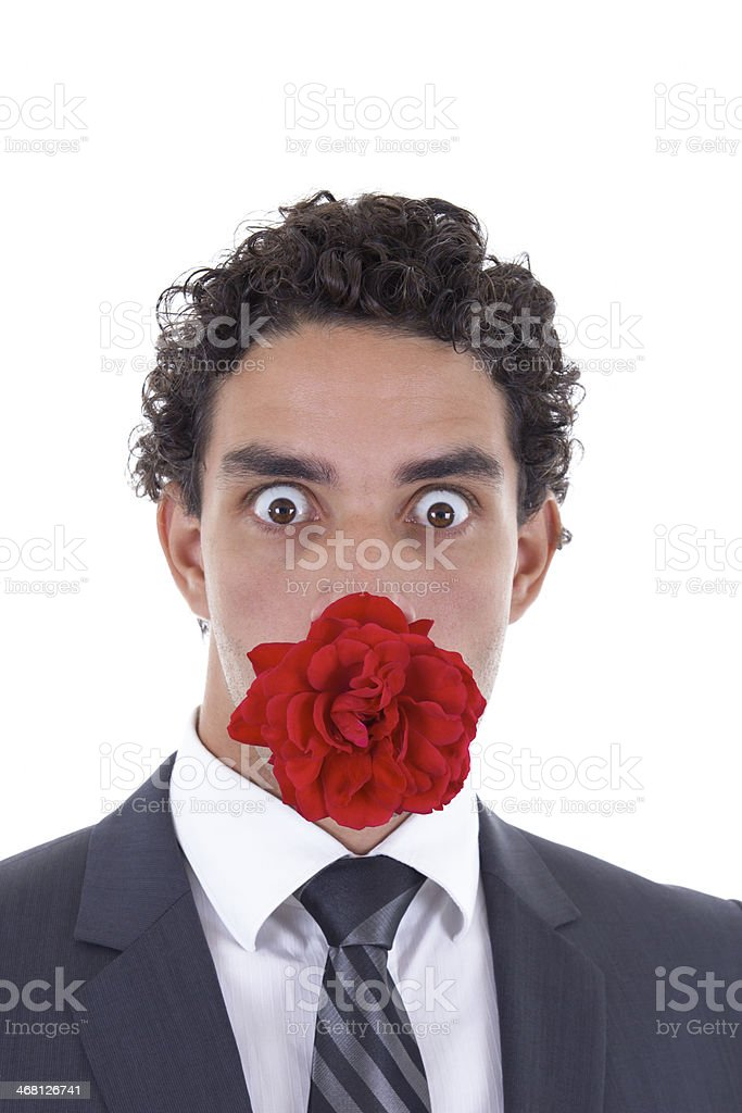 man with a rose in his mouth stock photo