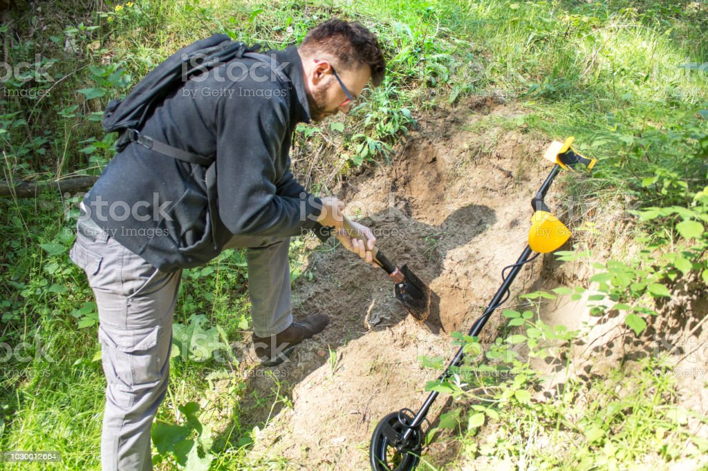 Jew Detector: Man With A Shovel In His Hands Digs A Hole In The Ground
