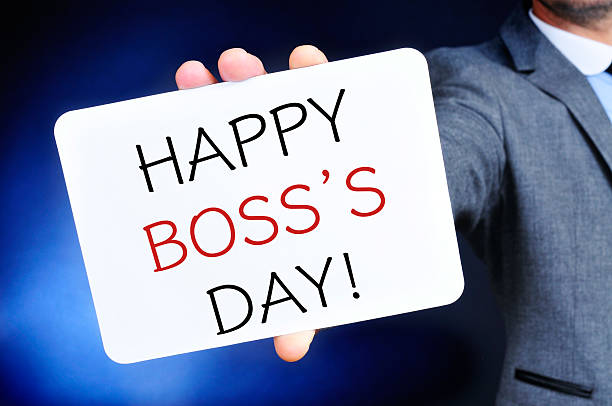 man with a signboard with the text happy boss day - boss's day fotografías e imágenes de stock