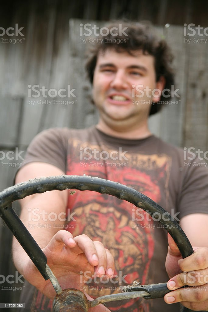 Man with a steering wheel stock photo