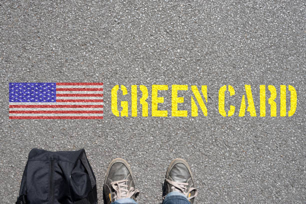 A man with a suitcase and the green card to the USA Ein Mann mit Koffer und die Green Card in die USA green card stock pictures, royalty-free photos & images