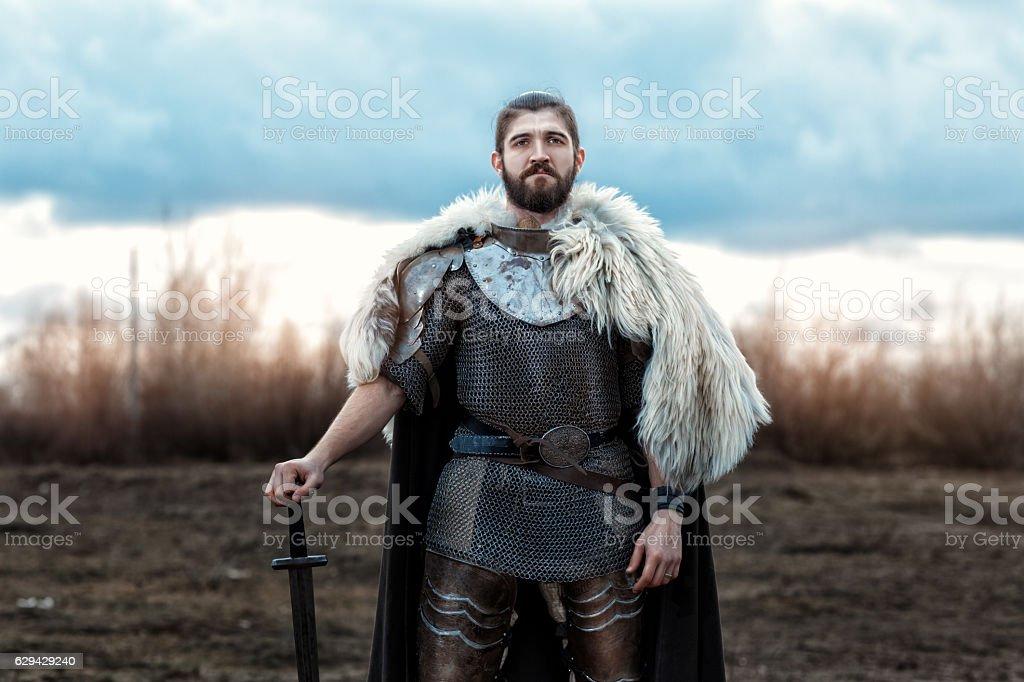 Man with a sword defenseman. stock photo