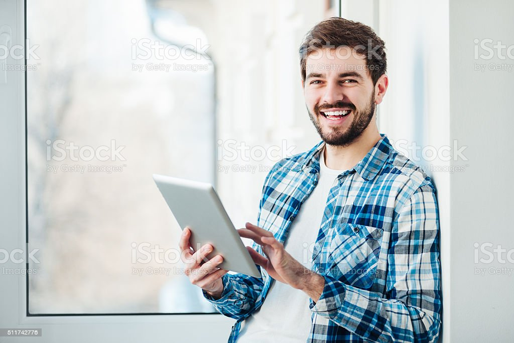 man with a tablet in his hands stock photo