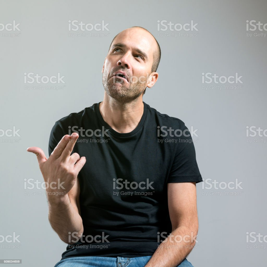 Man with a thoughtful face and ironic stock photo