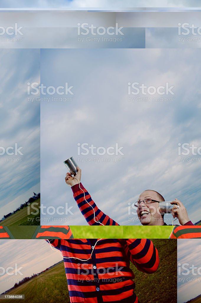 Man with a tin can phone searching for answers royalty-free stock photo