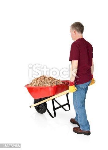 istock Man with a Wheelbarrow Full of Mulch 185272468