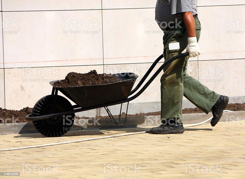 man with a wheelbarrow royalty-free stock photo